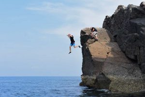 Jumping off Black Rock in Myanmar after geology lesson