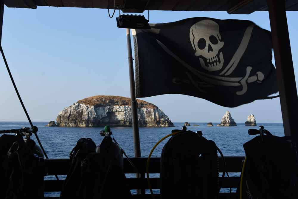 Pirate flag on Diva Andaman at Western Rocky dive site Myanmar